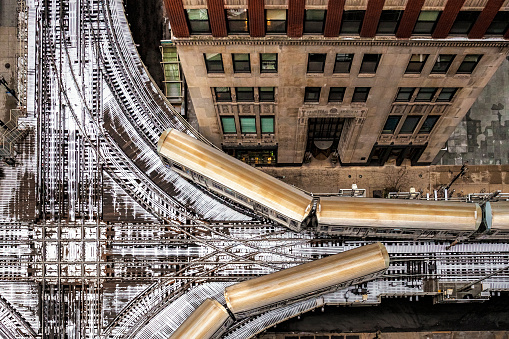 Chicago public transit trains  in the snow