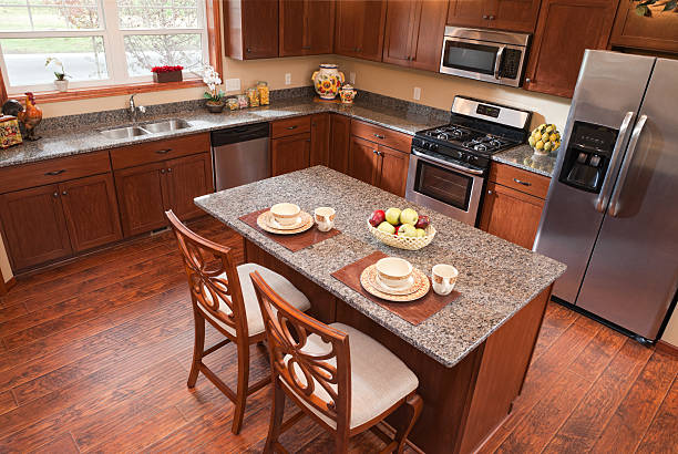 Elevated view looking down into a warm modern kitchen. stock photo