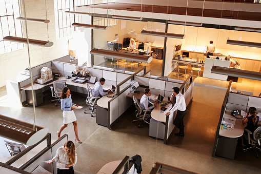 istock Elevated view of a busy open plan office 1011792694