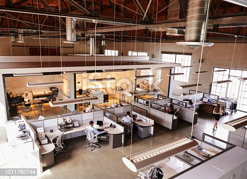 istock Elevated view of a busy open plan office 1011792744
