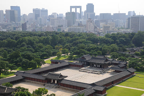 Elevated view of Chang-Gyeong Palace in front of a cityscape stock photo