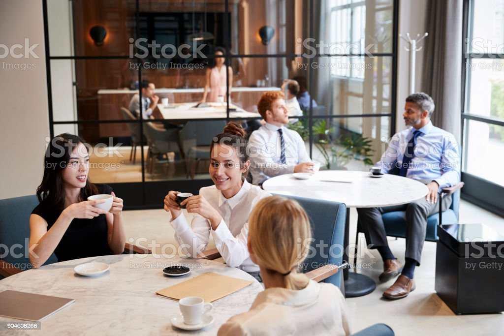 Elevated view of colleagues relaxing at their office cafe stock photo
