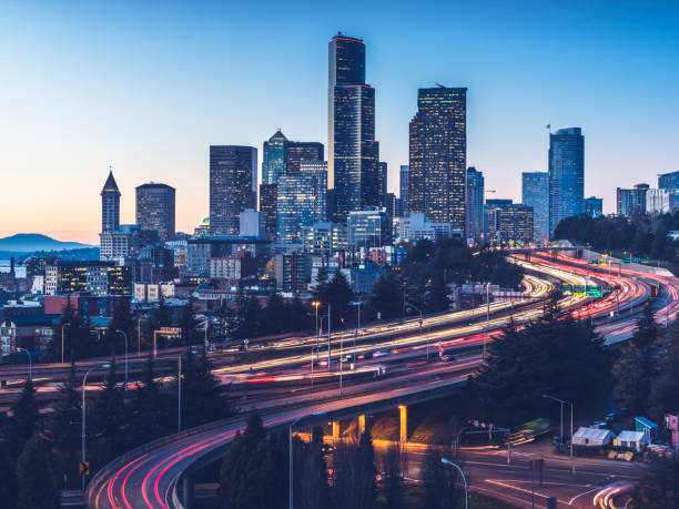 elevated view of interstate 5 and seattle downtown skyline - seattle стоковые фото и изображения