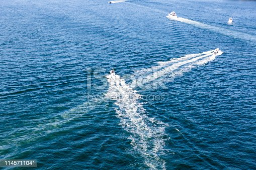istock Elevated view of motorboats traveling on ocean, background with copy space 1145711041