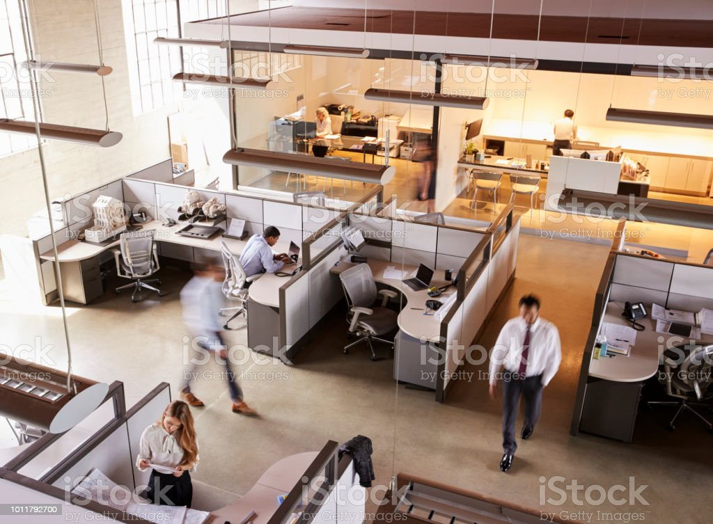 Elevated view of staff working in a busy open plan office stock photo