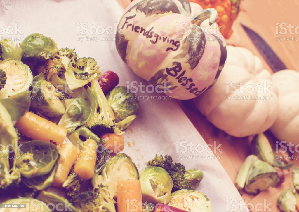 Elevated view of Thanksgiving food prep healthy vegetables with words Friendsgiving stock photo