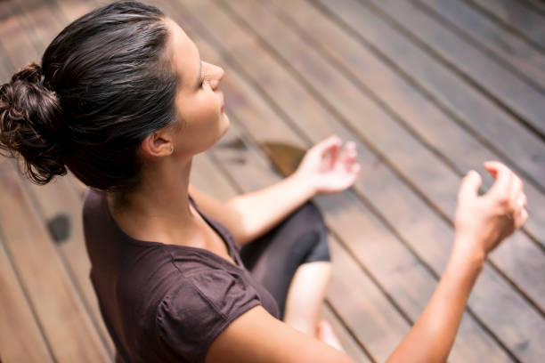 Elevated view of woman meditating stock photo