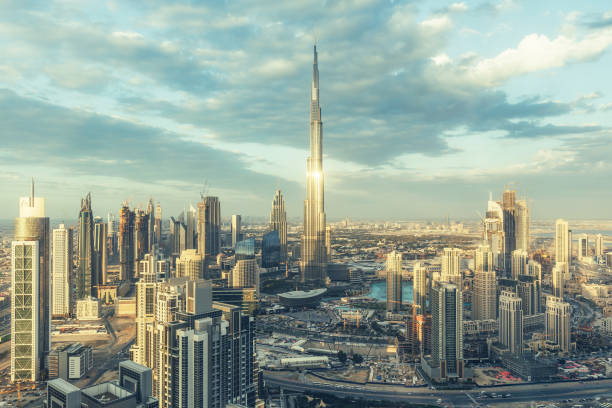DUBAI, UAE - FEBRUARY 18, 2017: Elevated view on downtown Dubai, UAE, with Burj Khalifa and skyscrapers of the business bay. DUBAI, UAE - FEBRUARY 18, 2017: Elevated view on downtown Dubai, UAE, with Burj Khalifa and skyscrapers of the business bay. burj khalifa stock pictures, royalty-free photos & images