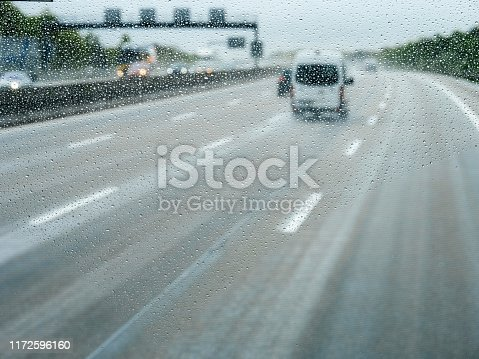 1127834626 istock photo Elevated view over the front driving white van 1172596160