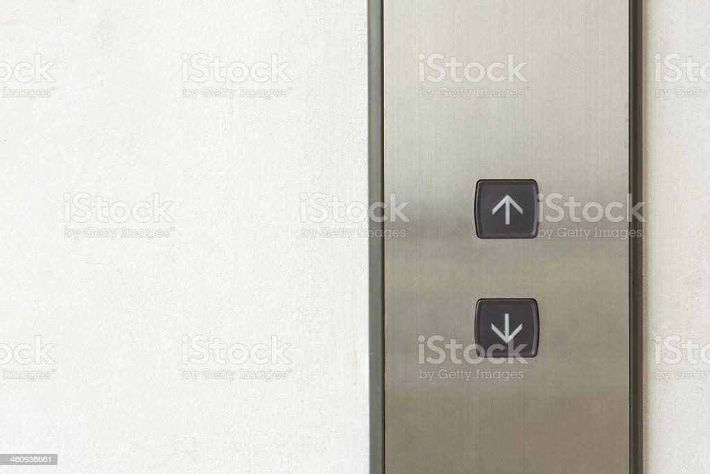 Ascensor botón hacia arriba y abajo de la dirección - foto de stock