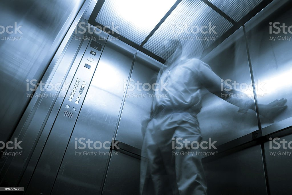 elevator claustrophobia; ghostly apparition in enclosed space stock photo