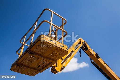 the basket of elevator crane with sky background