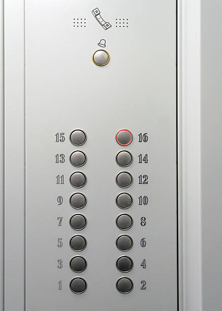 Elevator metal control panel with round buttons with numbers - foto de stock