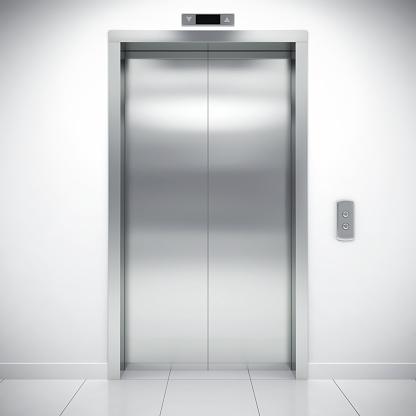 Closed modern elevator door in office building.