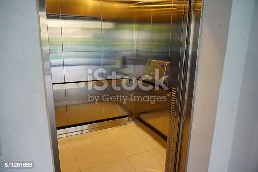 istock Elevator with sign for disable people 871281688