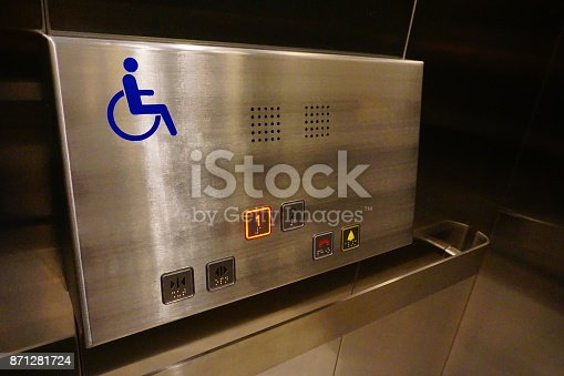 istock Elevator with sign for disable people 871281724