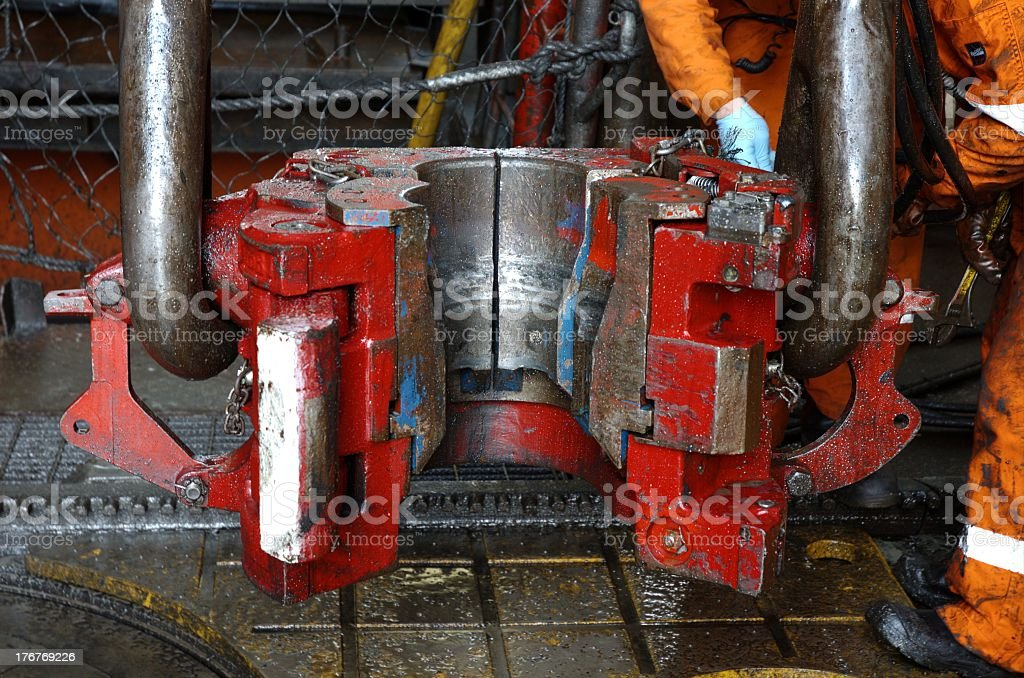 Elevators and bails on an offshore oil rig top drive stock photo
