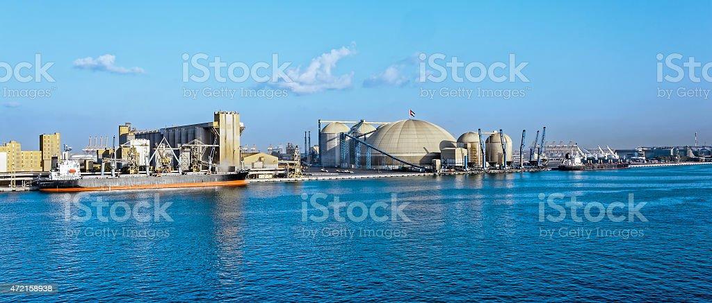 Elevators and grain loading on the vessel stock photo