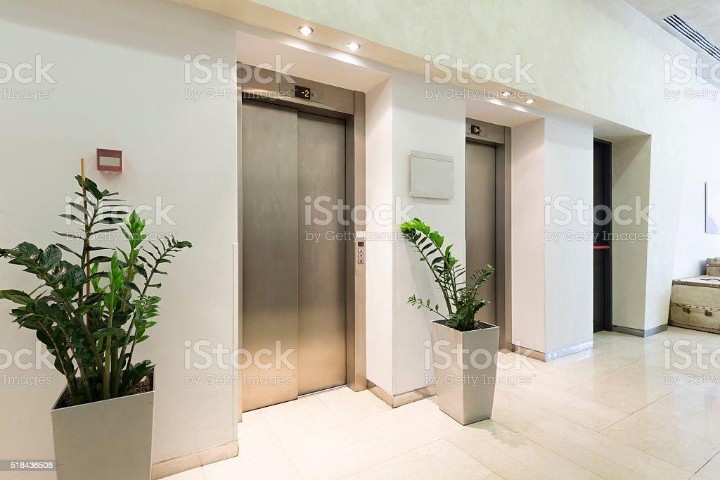 Elevators in hotel lobby stock photo