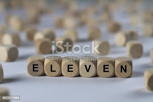 istock eleven - cube with letters, sign with wooden cubes 800522688