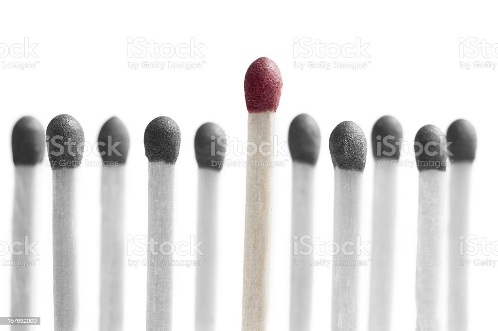 eleven matchsticks standing in a row one elevated stock photo