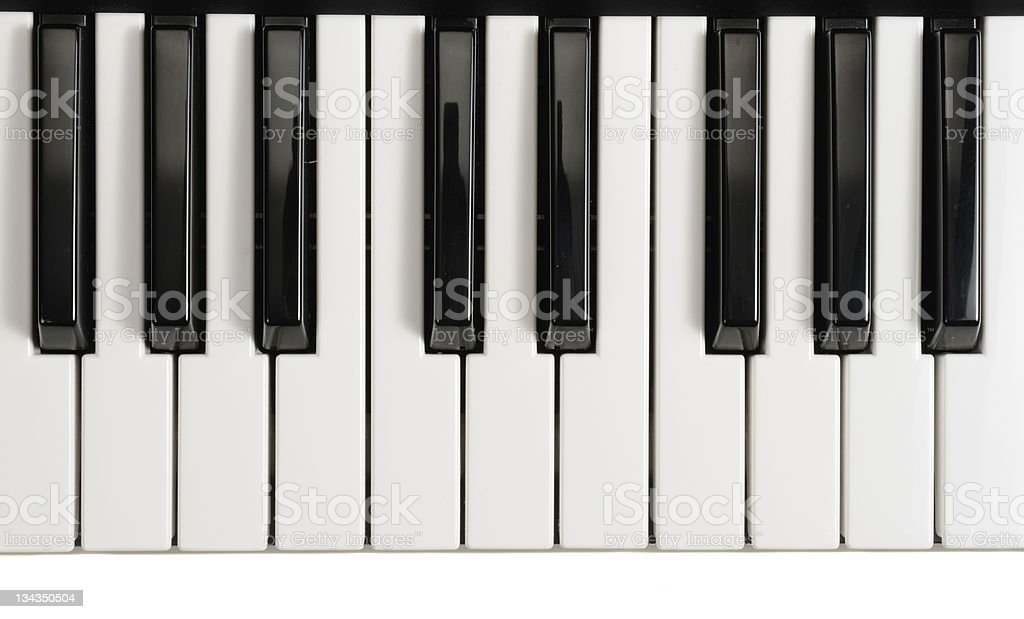 Eleven white piano keys and eight black keys stock photo