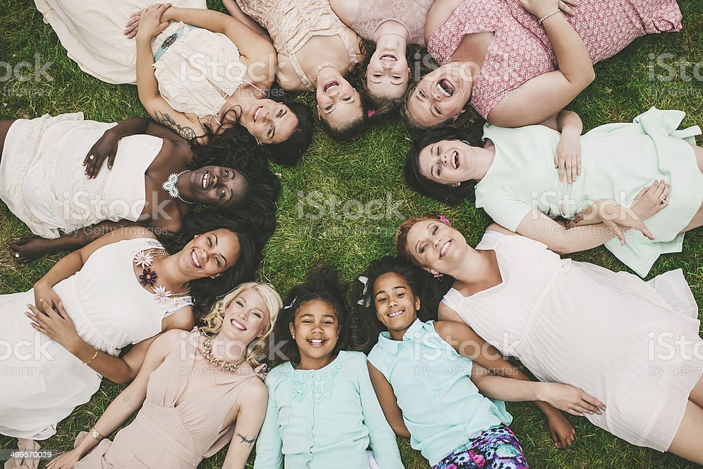 Eleven women in a cirle group of mothers and daughter stock photo