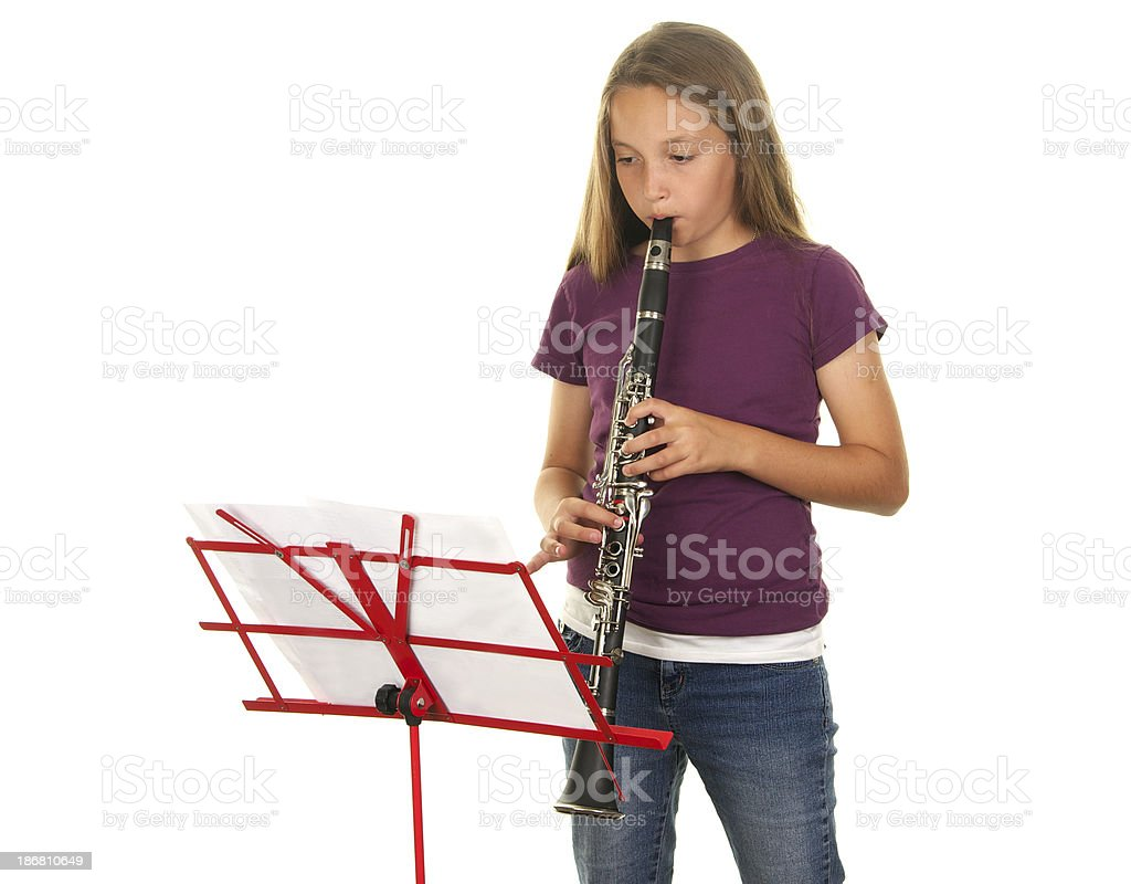 Eleven Year Old Girl Playing the Clarinet royalty-free stock photo