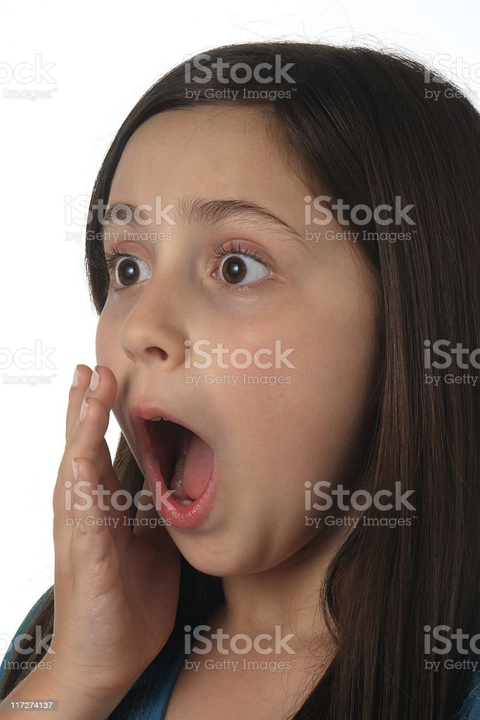 Eleven year old girl surprised, frightened royalty-free stock photo