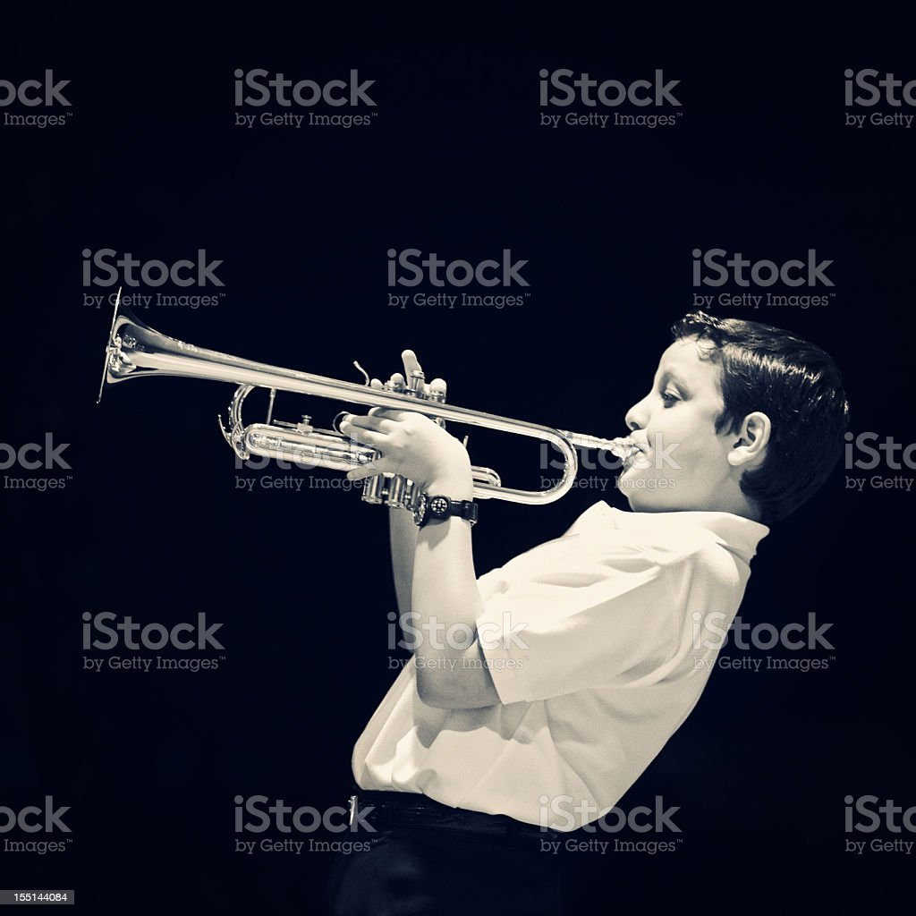 eleven years old kid playing the trumpet stock photo