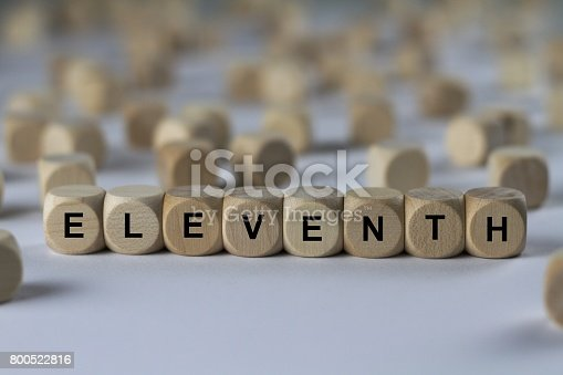 istock eleventh - cube with letters, sign with wooden cubes 800522816