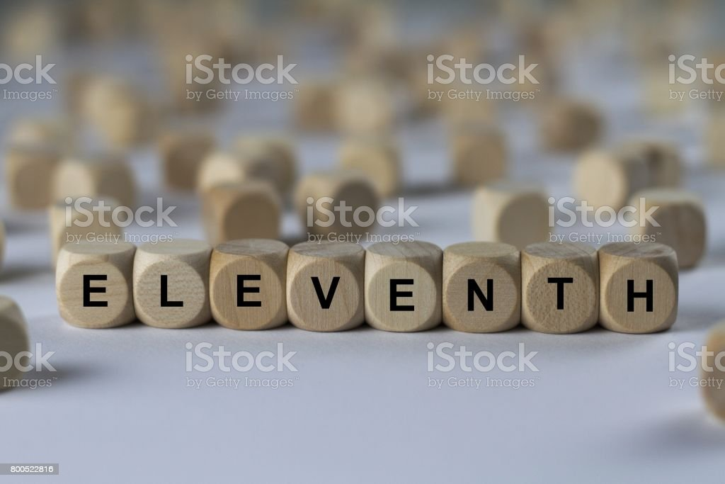 eleventh - cube with letters, sign with wooden cubes stock photo