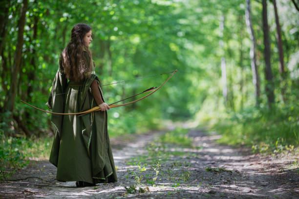 Elf archer from behind in the woods stock photo