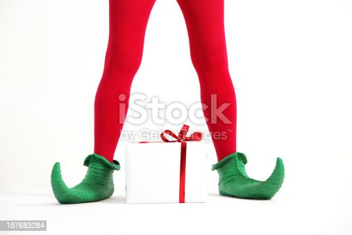 Elf legs with christmas present