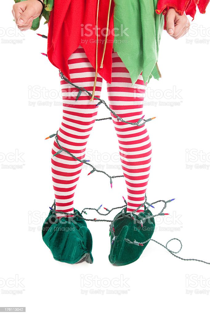 Elf Legs Tangled in Christmas Lights royalty-free stock photo