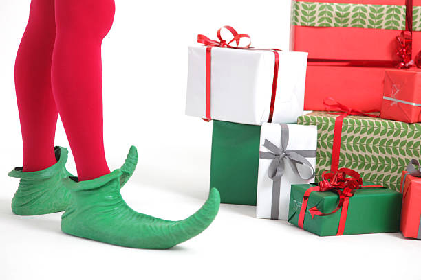 Elf with christmas presents stock photo
