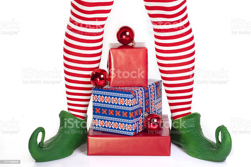 Elf's legs with presents stock photo