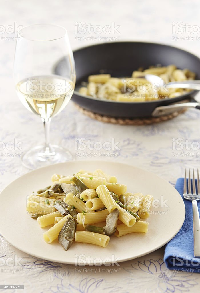 Elicoidale pasta with artichokes and green beans stock photo