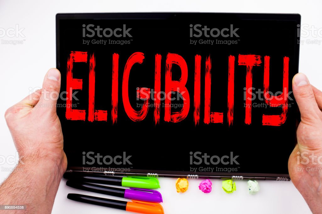 Eligibility text written on tablet, computer in the office with marker, pen, stationery. Business concept for Suitable Eligible Eligibility white background with copy space stock photo