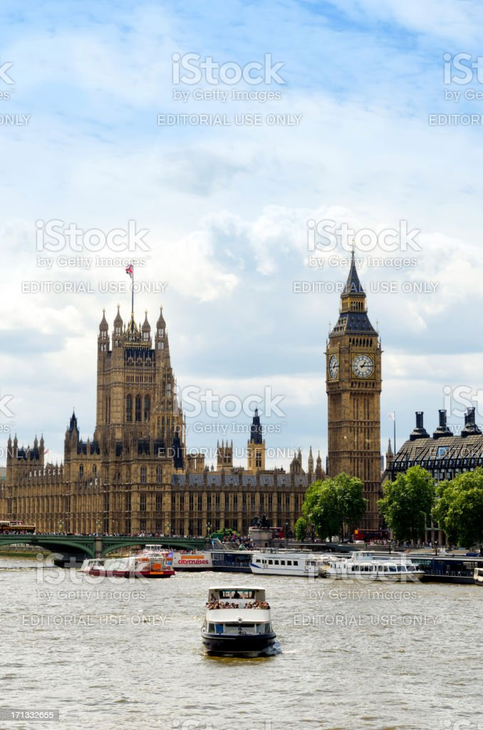 Elizabeth Tower, Houses of Parliament and tour boat royalty-free stock photo