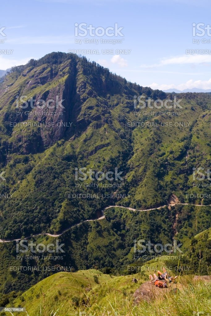 Ella, Sri Lanka, December 22, 2015: A man and a woman rest on the mountain above the gorge. stock photo