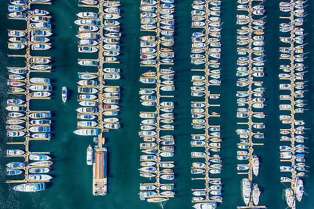 Elliot Bay Marina Aerial View - Seattle Washington An aerial view of the boats anchored in Smith Cove, Elliot Bay Marina located in Seattle Washington. mooring stock pictures, royalty-free photos & images