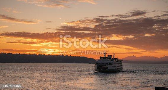 Elliott bay sunset with a Bainbridge Island ferry.