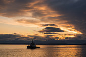A Tug Boat on Elliott Bay in Seattle at sunset.