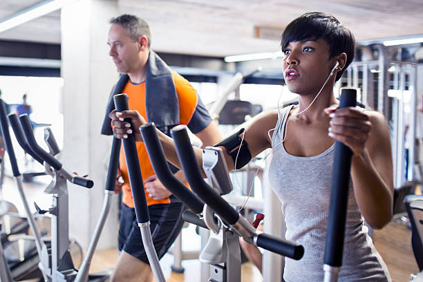 elliptical cross trainer - ellipse stock photos and pictures