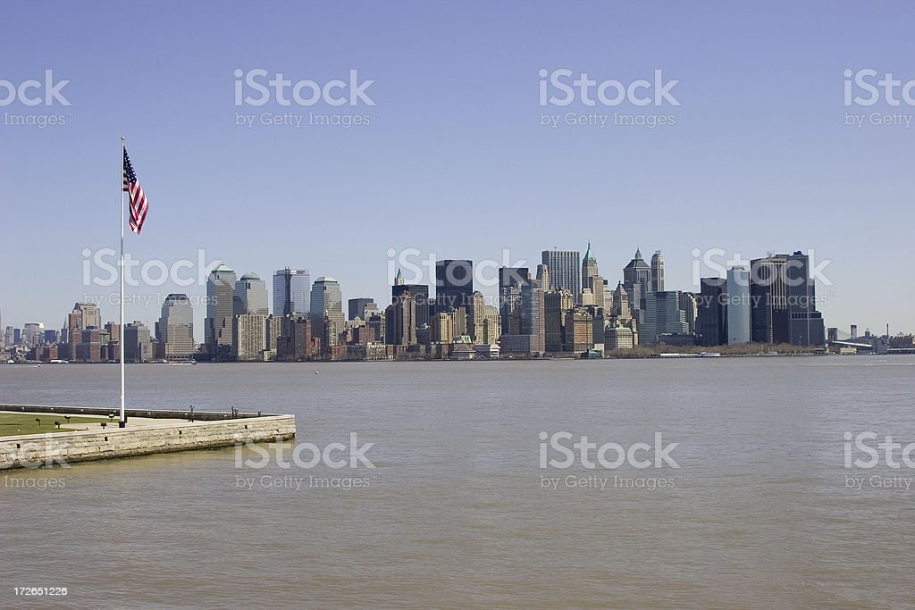 Ellis Island Flag and New York Skyline royalty-free stock photo