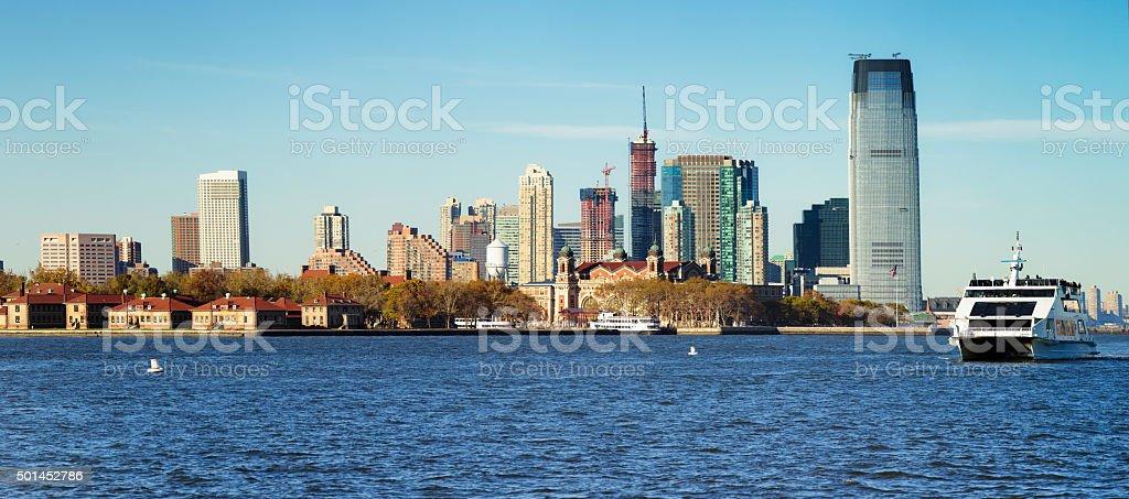 Ellis island, New Jersey shore and ferry panorama stock photo