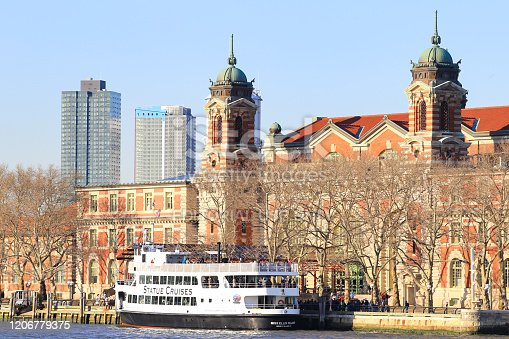 New York, NY, USA - February 17, 2019: Statue Cruise stopped by at the main entrance to the Immigration Museum at Ellis Island, New York City