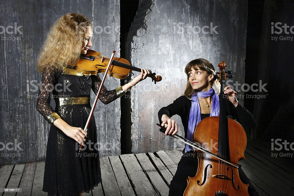 Сello and violin musicians royalty-free stock photo