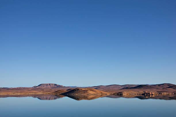 El-Mansour Eddabbi dam with mountains and reflections, Ouarzazate stock photo